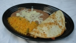 Fajita Quesadilla - Chicken or steak with rice and beans.<br />